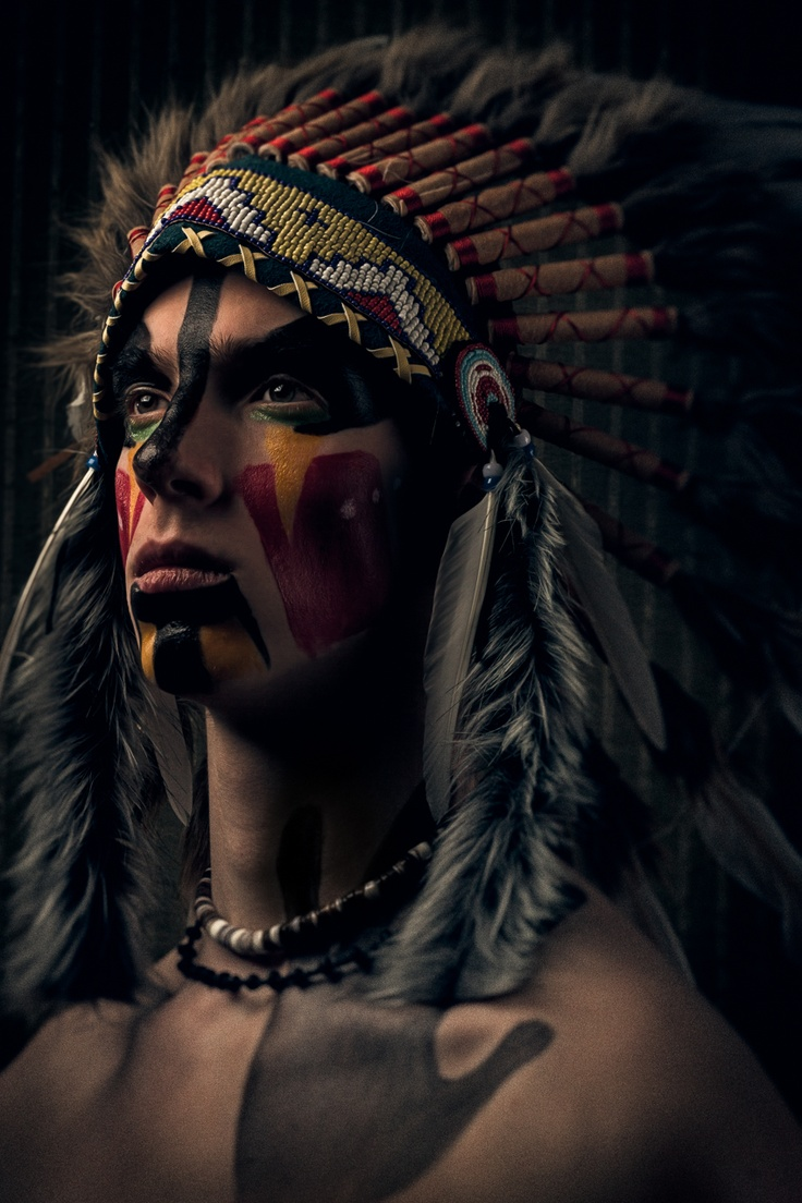 """""""The paintings on my face are actually the types of paintings that the War Chiefs of the Southern Native American tribes would have on their faces during war. The name of the photograph is 'Enkoodabaoo' and means 'The one who lives alone'."""""""