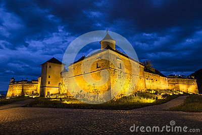Night view of Brasov Fortress. The citadel, part of Brasov's outer fortification system, was one of the strongest defensive citadels in Transylvania, Romania.