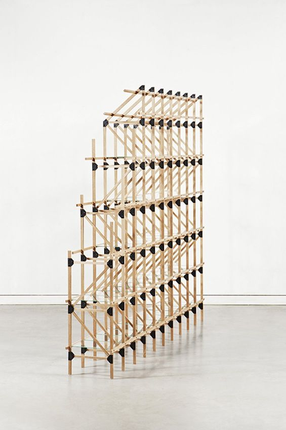 """Mieke Meijer précise:    """"Divider is a room divider annex shelving system. It is the first design in a new interior series based on lattice constructions.    Lattice constructions are extremely lightweight but stable structures which enable large spans with a minimal use of materials. Lattice girders can be found in, for example, bridges and buildings, but also in aircraft wings. A lattice construction is a framework composed of several parts that will be assembled in triangular shapes."""