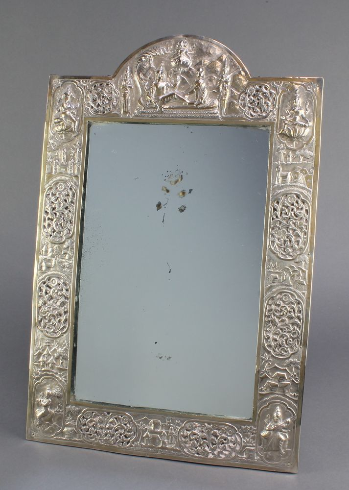 """Lot 660, A good early 20th Century Indian silver easel mirror, the repousse decoration with figures of Ganesh, Lakshmi  and other deities with panels of flowers and landscape views 18"""" x 11 3/4"""" est £200-300"""