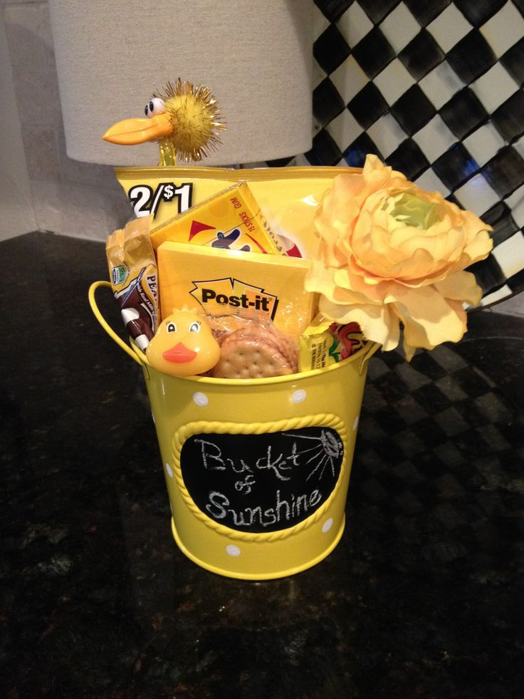 BUCKET OF SUNSHINE:  A great gift for someone who needs a little something to make it through the day.  Buy all things yellow - Juicy Fruit gum, peanut M&M's, PostIt notes, yellow flower, Lays potato chips - once you start looking, yellow things will jump out at you.  This was for my daughter's teacher on her first day back to school after maternity leave with her first baby.