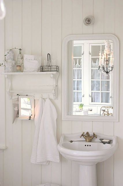 A beautiful vintage all white bathroom! I think this will look good in our log home one of these days!