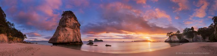 Cathedral Dawn | Cathedral Cove New Zealand  It was a glorious morning after the sun managed to penetrate the low bank of cloud at sunrise . I shot this on a Monday morning of a public holiday all to myself . I do feel much more in my element when shooting landscapes alone or with a trusted partner (ie. Marianne). Due to the dynamic range, this is 6 horizontal frames of 3 image blends. You can see the access point which is cathedral cave on the right hand side of the image.