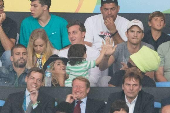 @barcastuff Milan Pique giving Ashton Kutcher a high five