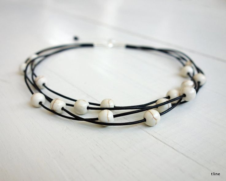 Layered statement choker howlite stones. Leather necklace in four cords with howlite stones. A modern rocker statement choker necklace.