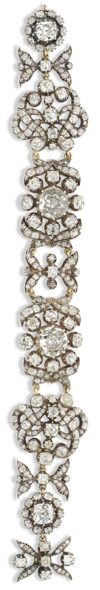 An antique diamond bracelet, 19th century. Composed of four highly stylised floral clusters, the two principal old brilliant-cut diamonds, connected by eternal knot and foliate motifs, set throughout with old brilliant and cushion-shaped diamonds, mounted in silver and gold, composite, the elements of this bracelet are probably circa 1830. #antique #bracelet