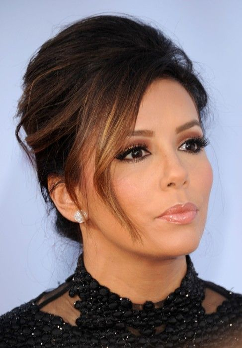 Eva Longoria Hairstyles: The light golden blonde manes are styled up into a stunning and graceful bun style and pinned to the crown making it ideal for women looking for a formal updo to compliment a round face. It is simple to re-create with hot-rollers and will be suitable for any special occasion. Tie the[Read the Rest]