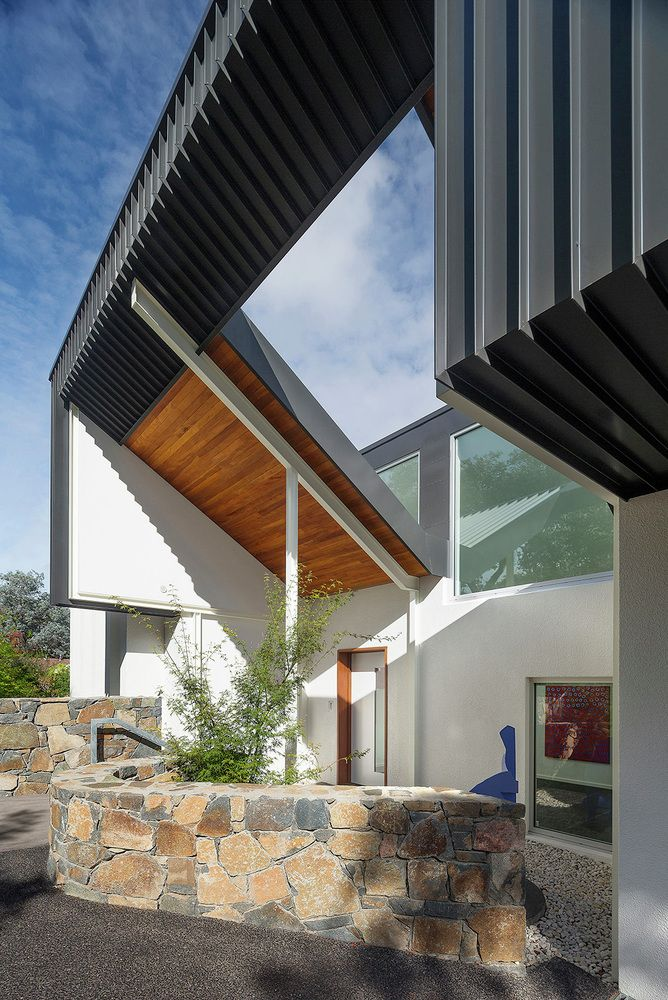 A stunning renovation to a 1960s home in Canberra, featuring a saw-tooth roof, warm timber cladding and a unique gallery space...