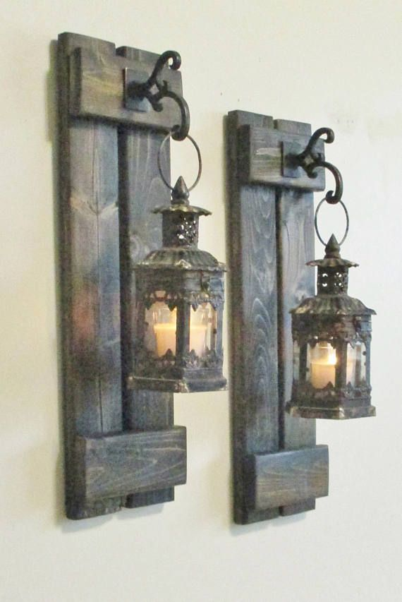 New Original Design to my shop. Larger rustic, primitive candle sconces that I created to look like small shutters.   Give your home a subtle, natural glow with this stylish Distressed Black Mini Lantern with Glass! They have a beautiful antique rusty finish. This old world-inspired lantern is ornate and distressed and features a simple latch for easy access. Please allow 2 - 2 1/2 weeks for all custom orders for completion prior  to shipping. All pieces are made entirely by me from star...
