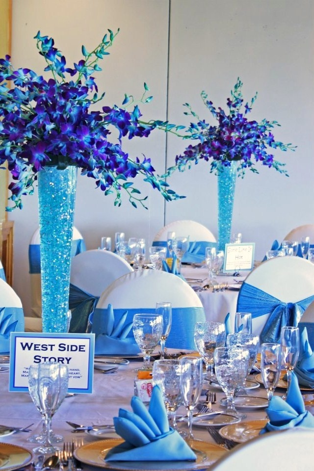 royal blue and silver wedding centerpieces%0A Our purple and turquoise floral centerpieces and turquoise lame u     chair  sashes and table linens M  s  Find this Pin and more on Royal Blue wedding