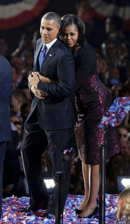 President and First Lady Obama share an embrace after the President was re-elected on Election Night. Shows the joy of the moment has passed and draws a sense of seriousness in celebration.