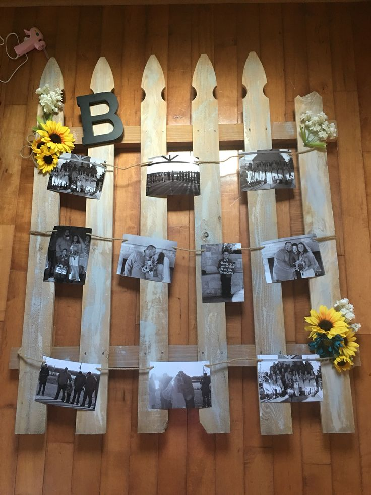 Wedding decor. Rustic wedding decor. Sunflowers. Picket fence decor. Black and white. Wedding photo display. Wedding photo collage.