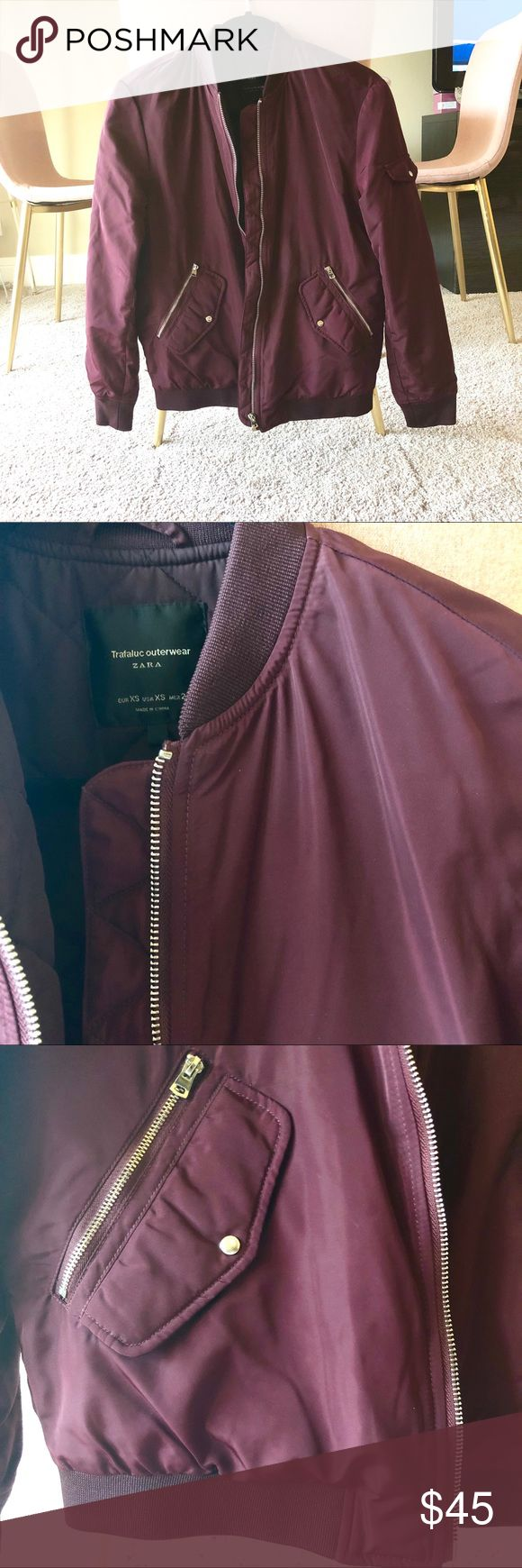 Zara Bomber Jacket Zara Bomber Jacket in Burgundy. 2 buttoned pockets and 2 zipper pockets.  Water resistant material. Light gold hardware. Not an overly puffy jacket, a very flattering women's style bomber without looking too large. Gently used, worn 5x. Zara Jackets & Coats