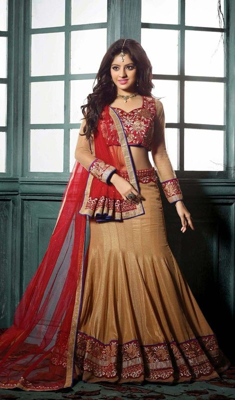 Classic beige embroidered georgette lehenga choli is a fish cut style. Lehenga which is embellished with lace and silk thread embroidered border in the hem and waist band (nefa) with scattered stones which makes you to look quite stylish and graceful. The contrast brick red net dupatta is embellished with woven lace, silk thread embroidered border with scattered crystal stones. The lehenga comes with contrast brick red velvet stitched blouse as shown in the picture. #IndianLehengaCholi