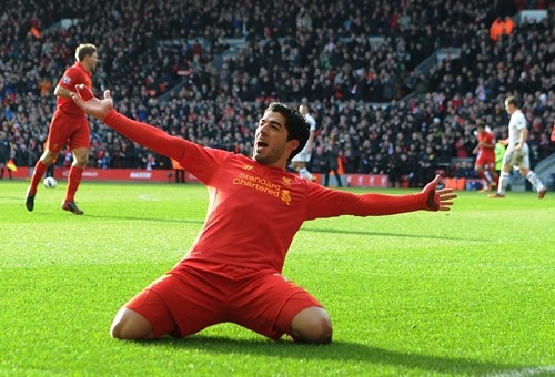 Luis Suarez fires Liverpool ahead at Anfield