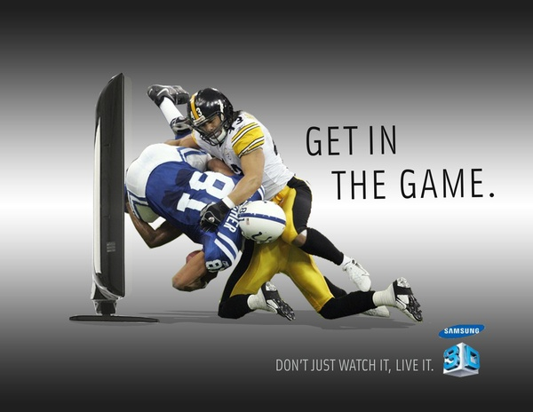 """This image is designed for middle and higher class people for them to catch the exact moment in a sport game. The slogan """"Get in the game"""" makes the sport lovers go crazy about buying the television. The television would catch most business people 's eye as they don't have the time to go for a game, buy they can now experience the true simulations at home. The idea of placing the sports players in front of the TV would make the TV more realistic."""