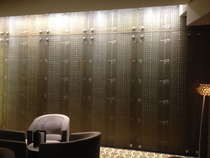 PHOTO 10: These slumped glass wall panels near the Mahogany Room create interest with an almost industrial look.