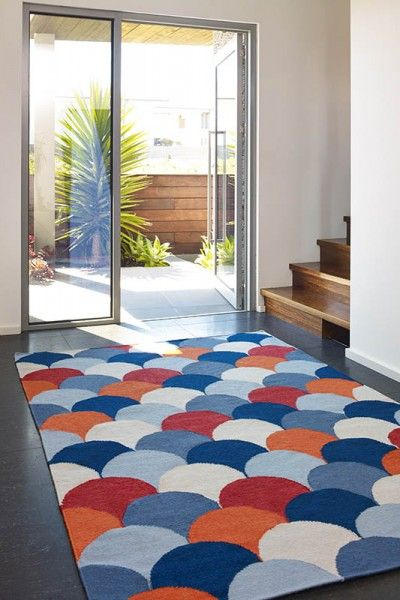 Malibu, Sweet - A vibrant blue, orange and red fish scale design flatweave NZ wool rug.  Available to see in store now and available to order in the following sizes:  160 x 230, 200 x 290, 250 x 350