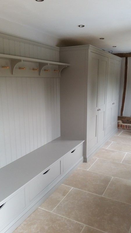 Bespoke boot room near Bishops Stortford on the Essex/Herts border. Clothes pegs in maple. Internals of cupboard and wardrobe are combination of solid oak and oak veneer. Underseat drawers on full extension soft-close runners