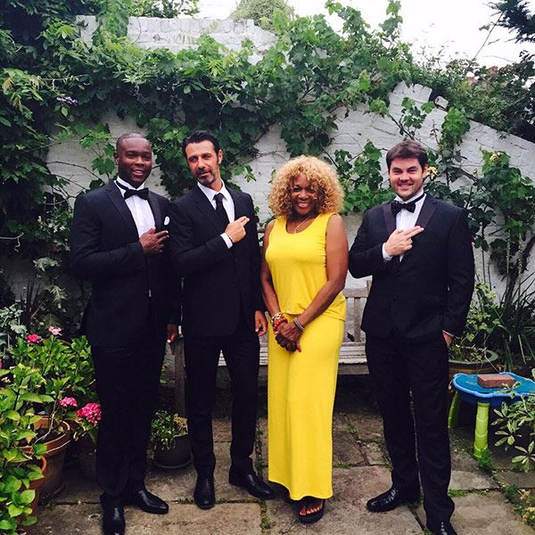 Patrick Mouratoglou (second from the left) next to Serena Williams' mother, Oracene Price