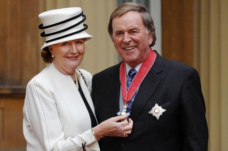 File photo dated 04/12/05 of Sir Terry Wogan with his wife Lady Helen, after the radio and television presenter collected his knighthood from Queen Elizabeth II during an investiture ceremony at Buckingham Palace.
