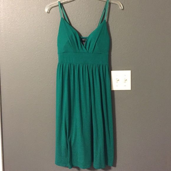 """Rue 21 dress Green Rue 21 dress has a stretchy back and adjustable straps. Ties in back. 47% polyester 47% rayon 6% spandex. Measures 33"""" in length Rue 21 Dresses"""