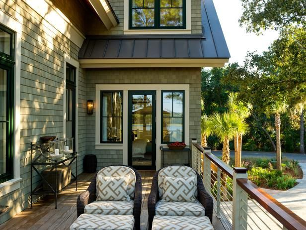 Brown windows white trim. green grey exterior paint, black and off white exterior trim