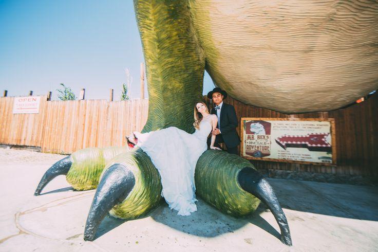 Wedding portrait by @christinaccraig at the Cabazon Dinosaurs in California    Dinosaur Wedding Photos Dinosaur Bridal