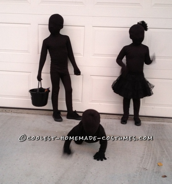Kids dressed as SHADOWS for Genius: Halloween - their mother bought black morph suits for them then layered black clothes over those. She says, This might be the easiest costume on earth. And from all of my costumes over the years, this one got the very best reaction.