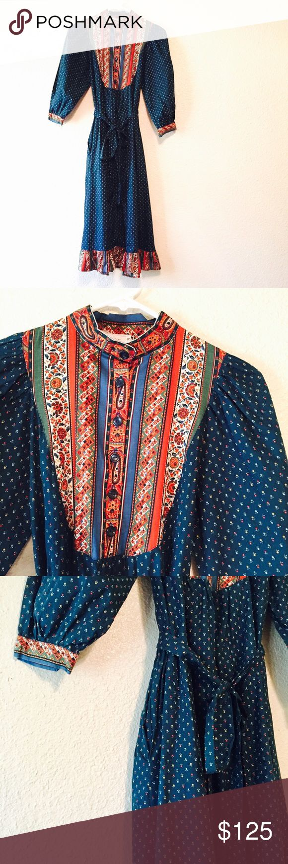 Incredible vintage paisley bohemian dress small Absolutely incredible and one-of-a-kind!! This vintage dress is in pristine condition for a vintage dress! It's a beautiful teal blue color with flower print. It's for red paisley accents as well. Perfect for any boho styled closet Jinx Senior brand, handcrafted and very high quality from Canada. Button down front at the top, side pockets, and tie waist. You'll fall in love with this! Size small. Vintage Dresses Midi