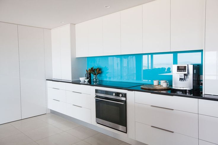 Coloured glass splashback in kitchen - Shepperd Building Company