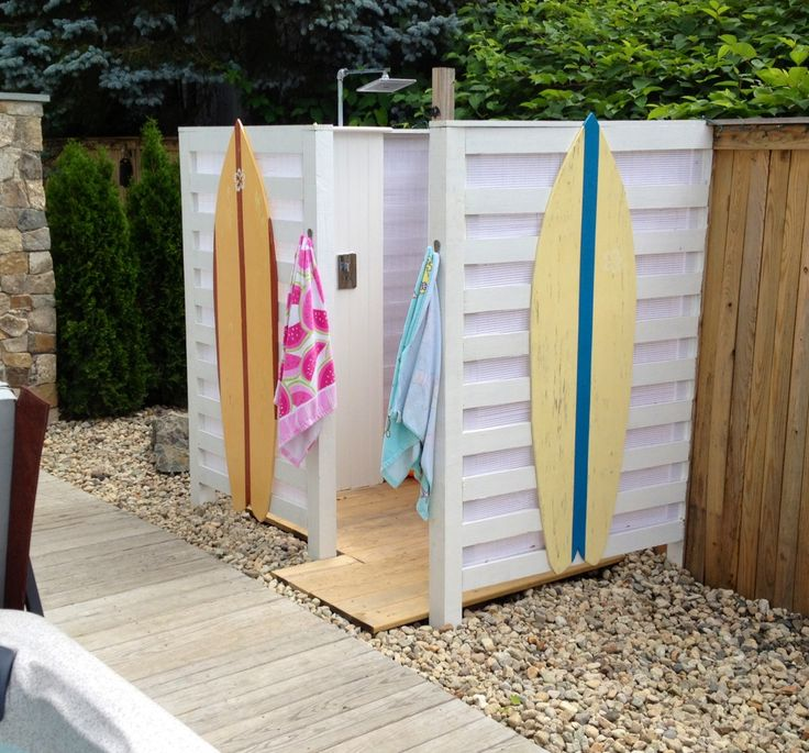 Cute, beachy outdoor shower with surfboard accents.