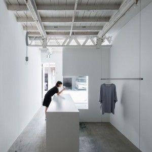 Reiichi Ikeda divides narrow Japanese  clothing boutique with boxy partitions  http://www.dezeen.com/2014/04/19/reiichi-ikeda-divides-narrow-japanese-clothing-boutique-with-boxy-partitions/