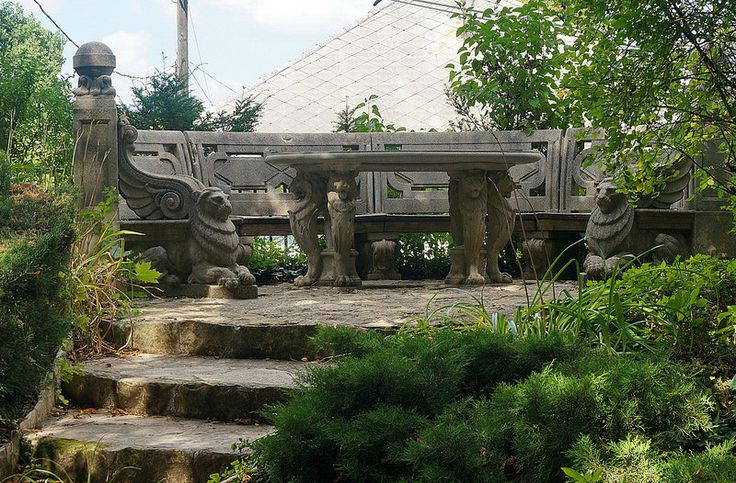 Budapest, Jókai Garden - Jókai's lion stone bench in his garden.  Budapest, Svábhegy (Schwab Hill in Buda Hills).  About Jókai Mór (Maurus Jokai), the greatest novelist of 19th century Hungarian literature (The Great Hungarian Storyteller):