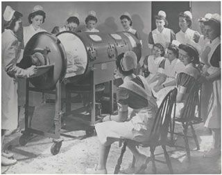 1958- instructing nurses on the use of a respirator for a polio patient....my mommy had polio in 1953