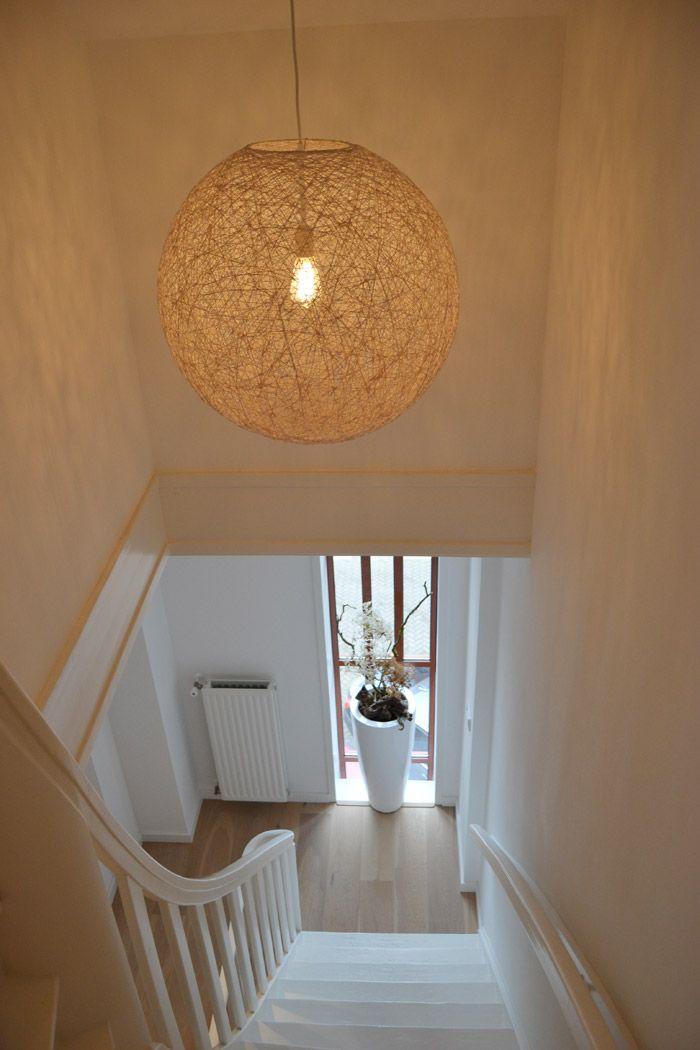 Moooi lamp in hallway.