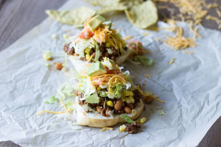 Sloppy Joesmeet tacos in this easy family pleasing meal! Get your bibs ready! Think back to your school lunches. Tostadas, pizzas, cheeseburgers, fish sticks, tater tots and sloppy joes. I loved sloppy joe day. It wasn't quite a burger, more like chili in a bun. It was messy and totally fun to eat. The best day ever was when I had sloppy joes at school and then mom served them up at home! Back then, sloppy joes were strictly made from a can. My mom didn't bother trying to make a…