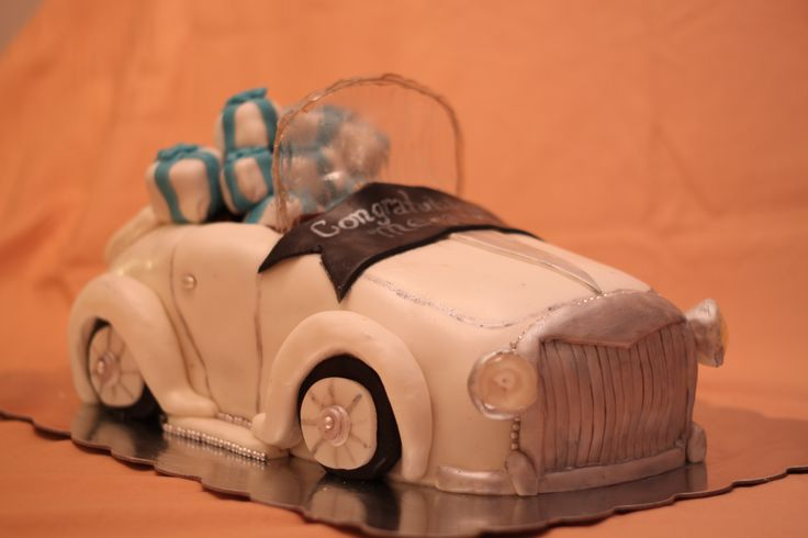 Classic Car Cake - This cake was carved and painted to look like a classic car filled with presents for a very good friend's bridal shower. Highlights include sugar headlights and brake lights, gelatin windshield and cake ball presents. Red velvet with cream cheese buttercream