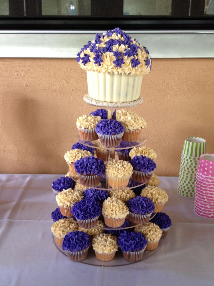 Giant purple and ivory cupcake tower.  Great for weddings.