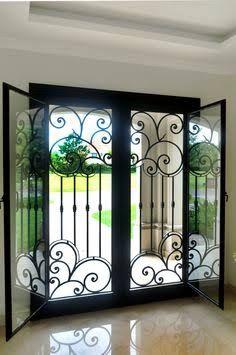 Resultado de imagen para puertas de hierro forjado para exteriores