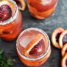 Blood Orange White Sangria in mason jars. Refreshing Thanksgiving Cocktail with a casual presentation.