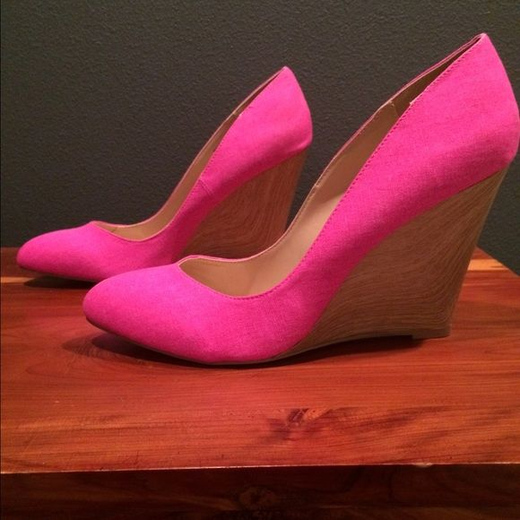NEVER WORN HOT PINK WEDGE PUMPS!! So cute! Hot pink fabric. Faux wood wedge heel. Never worn!!! Signature Shoes