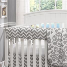 Rail covers replace bumpers as recommended by the American Pediatric Society. Gray Chevron baby bedding and rail covers.