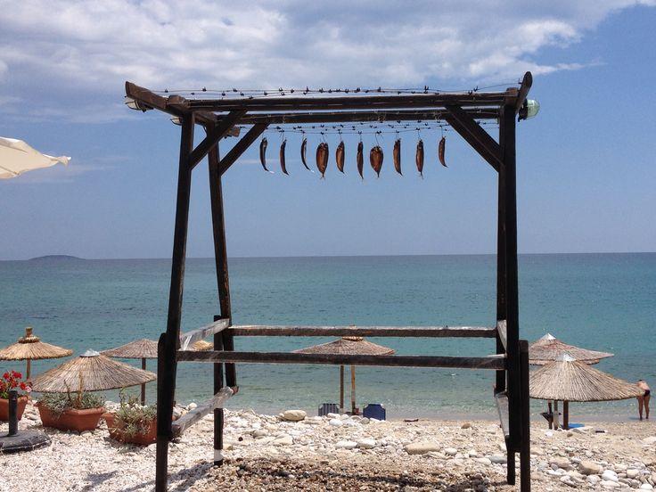 fish drying in the sun on greek island
