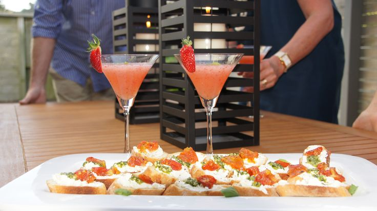 Crostini with pesto and slow-roasted vine tomatoes to accompany our daiquiris! #afreerangelife @Annabel Langbein
