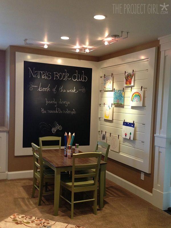 Basement idea....Kid's nook - love the framed chalk board and art display. by bernadette