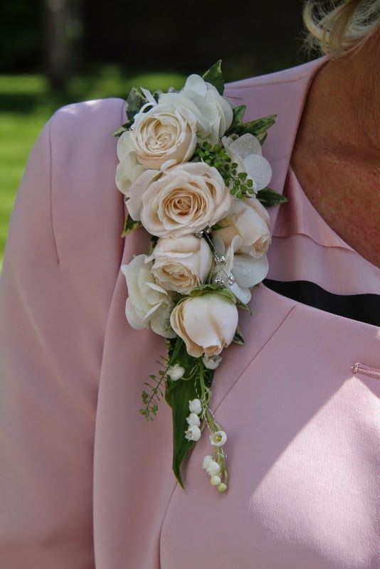 Exquisite pale Pink Corsage of Lily of the Valley and Bombastic Roses