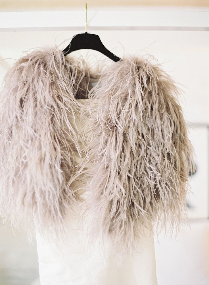 Glam gray feather bolero: http://www.stylemepretty.com/2016/02/17/trending-bridal-boleros-thatll-blow-your-mind/