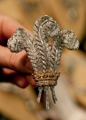 Wallis, the Duchess of Windsor's diamond Prince of Wales Brooch. Elizabeth Taylor bought it after Wallis's death at the auction of the Duchess' jewels in honour of her husband Richard Burton, who was from Wales. After Elizabeth Taylors death it was auctioned in December of 2011.