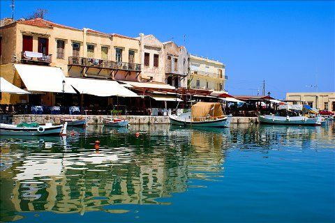 Boats moored on the sea front in the traditional city of Rethymno in Crete, Greece. http://www.jddiscounttravel.co.uk/destinations/europe/greece/crete/rethymnon/